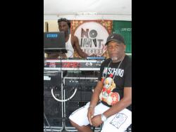 Neville 'Val-T' Thompson (right), sound manager of No Limit International, and disc jockey Ricardo Roberts.