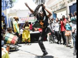 Dancer Oliver Morris of the Binghistra Orchestra performs in Water Lane, Kingston at a past staging of Kingston Creative Artwalk.