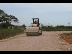 The farm road in St Jago, Toll Gate, Clarendon, being repaired.