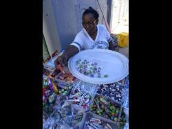 School-gate vendor Adassa Ross sorts through her wares.