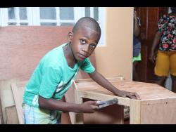 Eight-year-old carpenter Kaden Beckford.