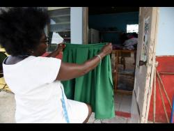 Maureen Pinto from Bedward Gardens near August Town in St Andrew, makes school uniforms but has seen tough times since schools were closed to face-to-face learning due to COVID-19.