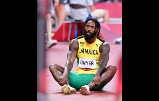 Jamaica's Rasheed Dwyer sits on the track after competing in the men's 200 metres final at the Tokyo 2020 Olympics Games, at the Tokyo Olympic Stadium in Tokyo, Japan, yesterday. Dwyer placed seventh in 20.21 seconds.