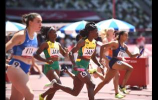 Remona Burchell passes the baton to Shericka Jackson on the final exchange in the women's 4x100 metres semi-final at the Tokyo 2020 Olympic Games, at the Tokyo Olympic Stadium in Tokyo, Japan, yesterday.