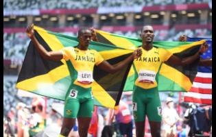 Jamaica's Hansle Parchment (right), the gold medal winner and Ronald Levy, who won silver, celebrate after the men's 110 metres hurdles final at the Tokyo 2020 Olympics Games at the Tokyo Olympic Stadium in Tokyo, Japan, on Thursday morning (Japan time).