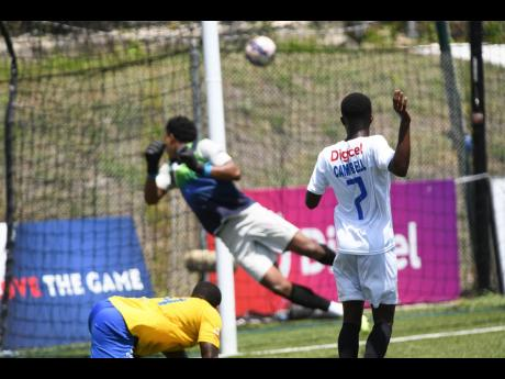 Mount Pleasant's Devonte Campbell (right) slams the ball into the back of the net past  Harbour View's goalkeeper Tafari Chambers during last weekend's Jamaica Premier League quarterfinal match at the UWI-JFF Captain Horace Burrell Centre of Excellence.